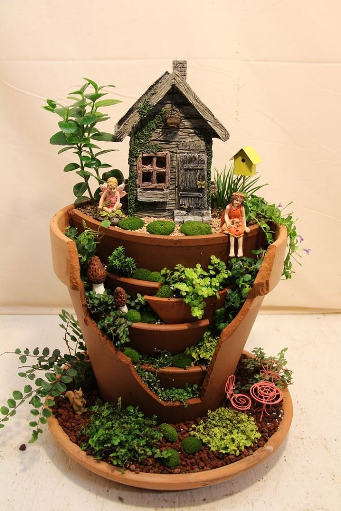 Mini fairy garden inside clay pots