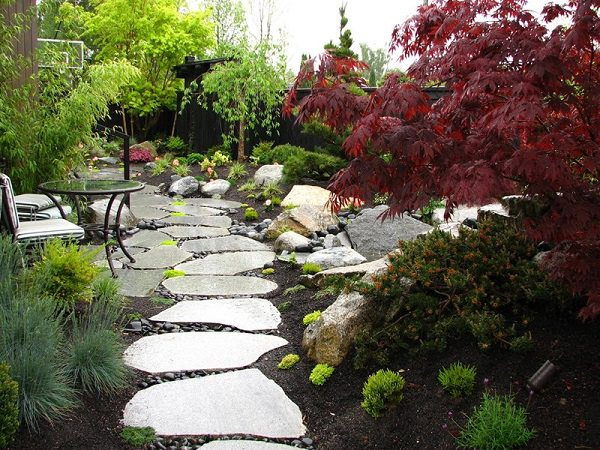 stone paths are ideal if you want to add more naturalness to your garden they come in different sizes and texture and so each stone is unique - Garden Path Ideas