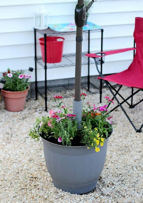 With these 9 DIY Umbrella Stand Planter Ideas, you can grow plants and have shade at the same time!