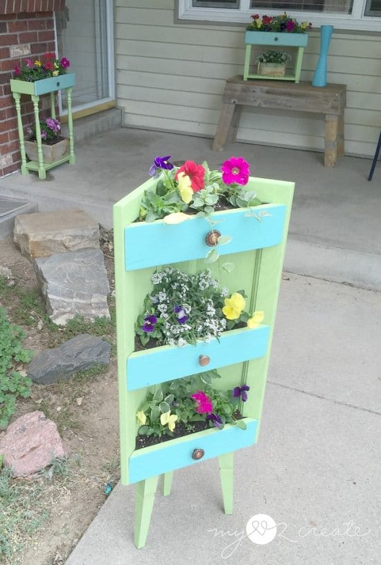 Make expensive looking and movable DIY Repurposed Planters from old filing cabinets and save a lot of money you'd been splurging on large planters.