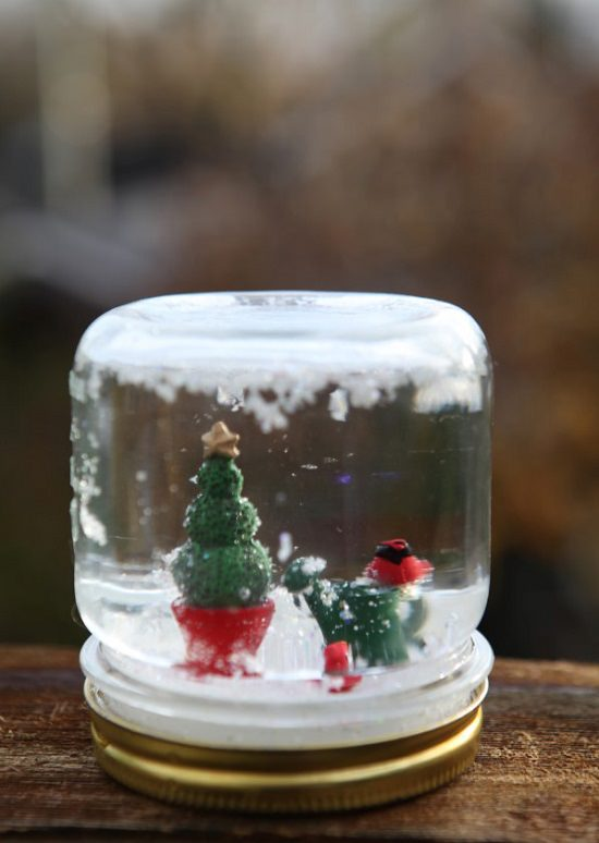 These Miniature Christmas Fairy Garden Ideas are perfect for tabletop decorations or keep them near your Christmas tree.